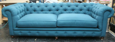 button tufted chesterfield sofa after