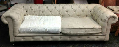 diamond tufted chesterifled sofa before