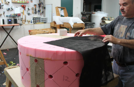 building of diamond-tufted ottoman