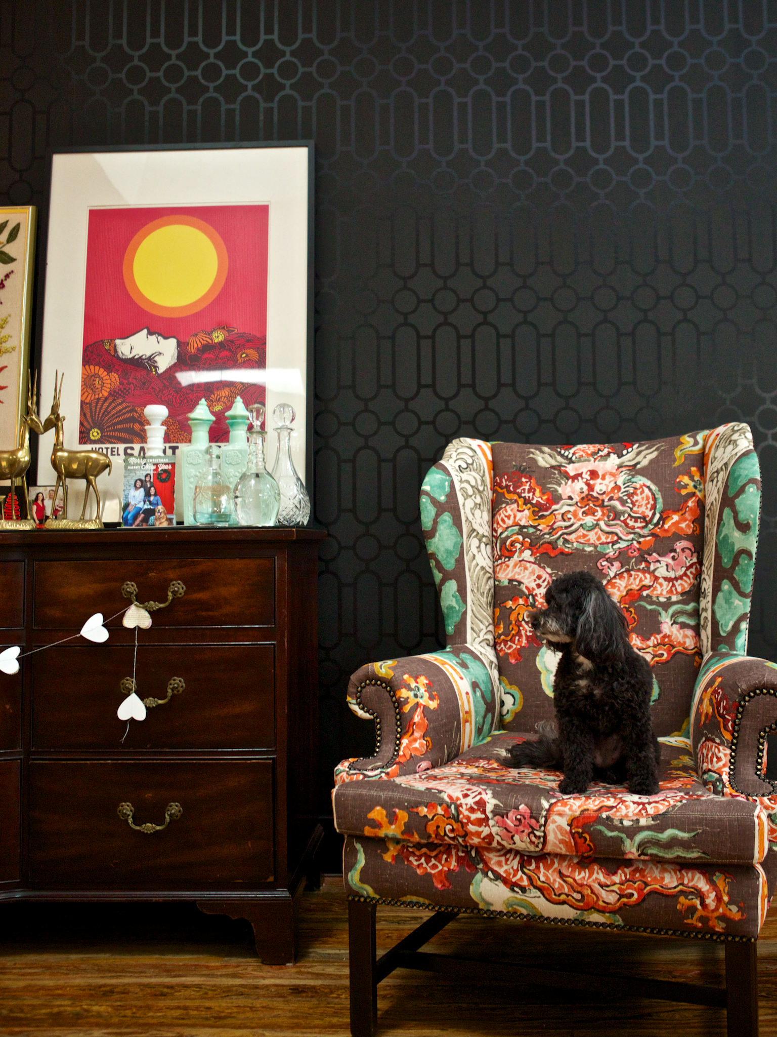 Pixie takes a seat on Amanda's wingback chair, which was featured on the cover of her book, Spruce: A Step-by-Step Guide to  Upholstery and Design.